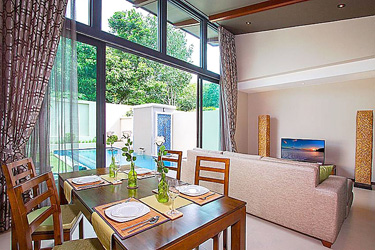 Dining and Living Area with Pool and Garden View