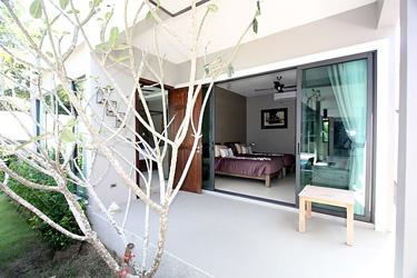 Second Bedroom, and Terrace with Garden and Pool View