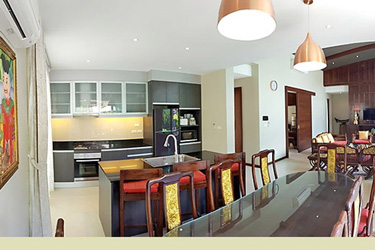 Dining, Living and Kitchen Area with Garden and Pool View