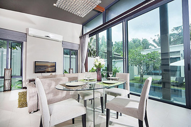 Dining and Living Area with Garden and Pool View