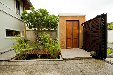Front Garden with Fishpond, Welcome Gate and Carport