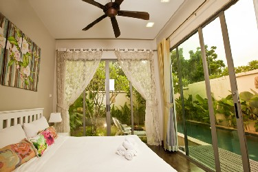 Second Bedroom with View to the Garden, Terrace and the Pool